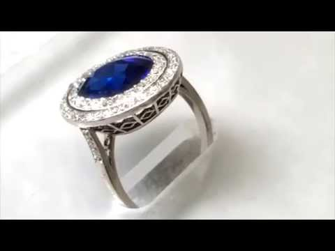 Blue Sapphire and Diamond Double Halo Birthstone Ring