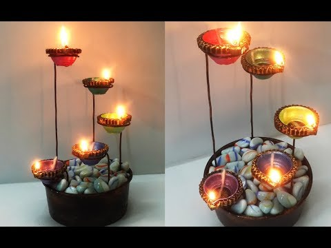 Beautiful diya stand for diwali decoration easy diya for Candle decoration with waste material