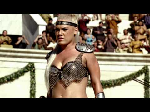 Rocking you - http://www.glassworks.co.uk/ The commercial is set in the Roman Coliseum. A gladiatorial combat between 3 lady gladiators is about to occur. They come out to...