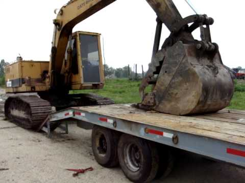 excavator loading on tag trailer