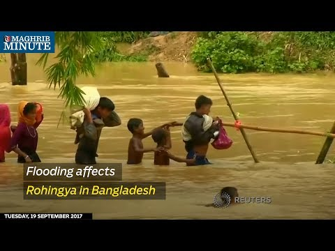 Heavy rain has flooded rice paddy fields where many Rohingya Muslims have put up their shelters