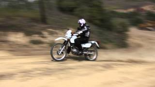 10. The 2013 Suzuki DR200SE in the dirt.