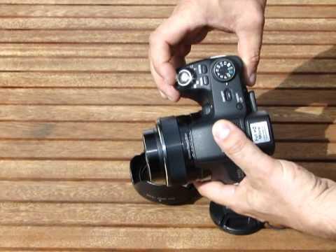how to attach lens cap to sony hx100v