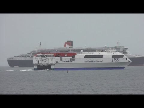 Laoghaire - The Stena H.S.S. Explorer passes the RMS Queen Mary 2 cruise liner as it departs Dun Laoghaire harbour on the 16th of May 2013. The QM2 is the largest ocean ...