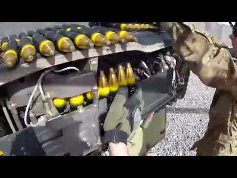 POV video displaying how 30mm rounds are loaded onto an Apache helicoper