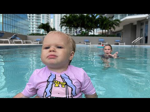 Maggie is swimming with little baby Naomi in the swimming pool