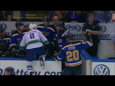 wrong - Vancouver Canucks forward Zack Kassian tries to hop on the bench after noticing there were too many men, but instead ends up on the St. Louis Blues bench.