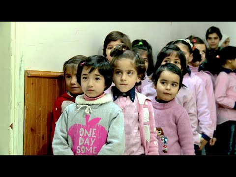 Syria: Homs war children find home in abandoned hotel