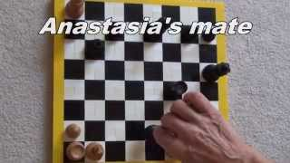 Chess board where the playing surface is the sides of Lego bricks - this lets the pieces move smoothly without having to use plates. Demo endgame using Anastasia's mate.