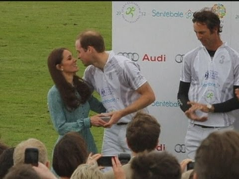 Kiss me Kate! William and Harry get a peck on the cheek from the Duchess of Cambridge Video