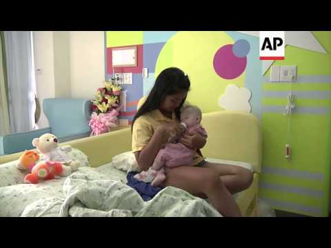 Surrogate mother speaks out after Australian parents reject Downs baby