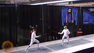 This is a semifinal bout in the men's epee event at the NCAA fencing championships in Indianapolis, Indiana. Ariel SImmons of Notre Dame is on the right and Cooper Schumacher of St. Johns University is on the left.