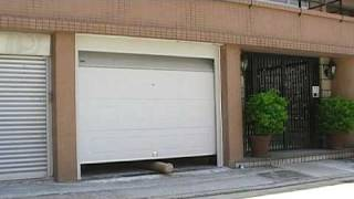 How should a garage door be tested for child safety?