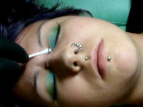 pierced - Me, getting my bridge pierced by Megan @ Wicked Needlez Custom Tattoos and Body Piercings.