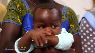A baby girl born with four legs and two spines was reunited with her parents in the Ivory Coast after a successful surgery in the United States.