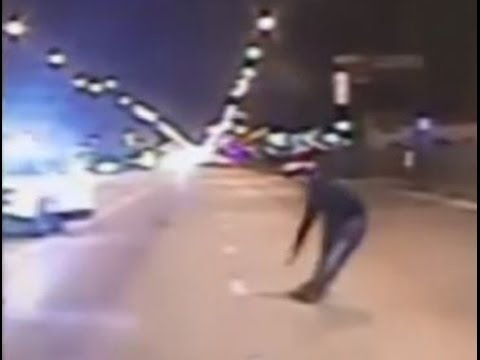 A video shows a white police officer fatally shooting 17-year-old black teenager Laquan McDonald in Chicago.