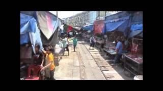 Maeklong Train Market, Filmed From The Train -  Market On The Railway - Bangkok Thailand