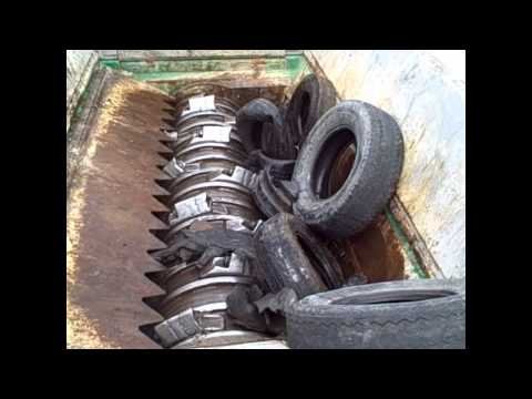 Komptech Terminator UF Shredding Tires.wmv