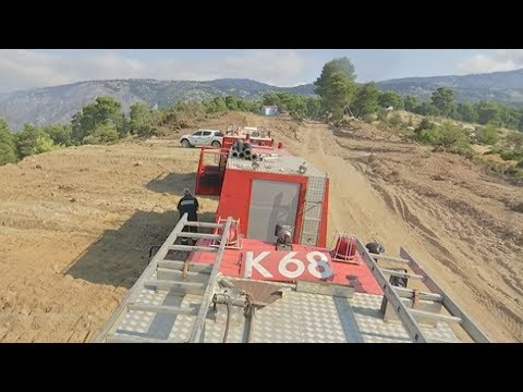 Μάχη με τις αναζωπυρώσεις δίνουν οι πυροσβέστες στην Εύβοια