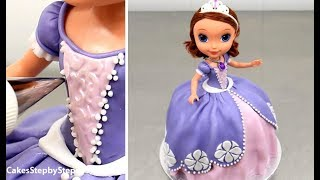 """Sofia The First Disney Princess Doll Cake - How To Decorate by Cakes StepbyStepMore kids cakes decorating videos from Cakes StepbyStep:How To Make a Disney SNOW WHITE Cake - Pastel BLANCANIEVEShttps://youtu.be/kZ-m7yYVNxMBarbie Fashion Doll Cake https://youtu.be/Xium61g7TVEDisney Princess Cinderella Doll Cake How To Make https://youtu.be/cohsTchwMg8How To Make a Disney PRINCESS SOFIA  Cake https://youtu.be/yOS-CtYtG6YHow To Make a Disney MINNIE MOUSE Cake - Pastel de la Minnie https://youtu.be/bZEgv6_BMxMTo stay up to date with my latest videos, make sure to SUBSCRIBE to this YouTube channel (if you are not).To find out more about the items I use, please visit: http://www.cakesstepbystep.com/You can support this channel by sharing my videos. Thank you!************************FOLLOW ME*********************************INSTAGRAM  http://instagram.com/cakesstepbystep/*FACEBOOK     https://www.facebook.com/cakesstepbystep/Cakes StepbyStep is about cakes and cupcakes decorating with fondant and buttercream frosting. Also you can watch simple chocolate decoration techniques and cake recipes. Learn with me basic cake decoration techniques which will help you to decorate your own cake masterpiece. ***********HAVE FUN!Music credit""""Beachball""""Artist: Silver Dolphin Musichttps://www.youtube.com/user/silverdolphinmusichttp://silverdolphinmusic.weebly.com/License Creative Commons CC BYhttp://creativecommons.org/licenses/by/4.0/#""""Fireworks""""Artist: Silver Dolphin Musichttps://www.youtube.com/user/silverdolphinmusichttp://silverdolphinmusic.weebly.com/License Creative Commons CC BYhttp://creativecommons.org/licenses/by/4.0/#""""Sprinkle Star""""Artist: Silver Dolphin Musichttps://www.youtube.com/user/silverdolphinmusichttp://silverdolphinmusic.weebly.com/License Creative Commons CC BYhttp://creativecommons.org/licenses/by/4.0/#"""