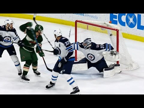 Video: Granlund perfectly tips puck by Hellebuyck to give Wild early lead