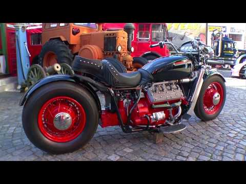 Moto V8 armada con piezas de autos