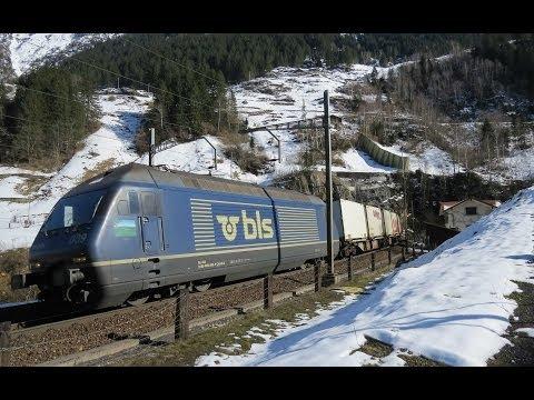 Züge auf der Gotthard-Eisenbahn März 2014 mit Re 460 Coop Werbelok – Zug, trainfart, train