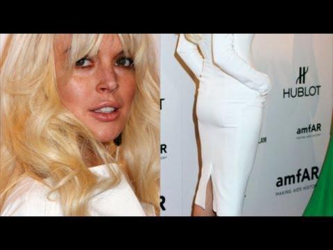 Lindsay Lohan dons a TIGHT fitting dress