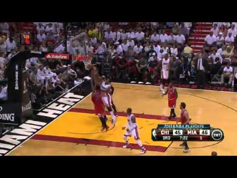 heat - Nate Robinson scores 27 points and dishes out nine assists as the Bulls drop the Heat in Game 1.