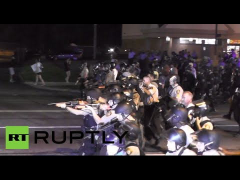 High - Protests over the killing of unarmed black teenager Michael Brown by a police officer continued on Monday night, as police used tear gas to disperse protesters clustered in large groups. Live...