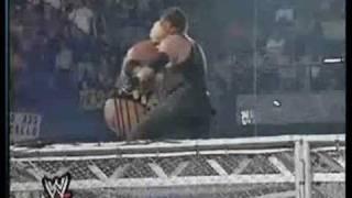 Undertaker throws Rikishi