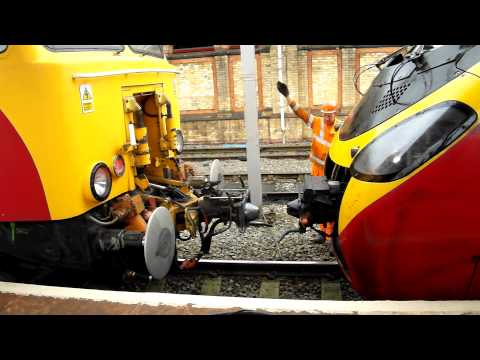Virgin Trains Class 57 Thunderbird Coupling to a Virgin class 390 Pendolino at crewe