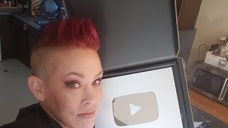 Live in the Fishroom- Showing off my Play Button by Rachel O'Leary