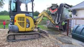 A shed foundation is prepared using a variety of machinery.