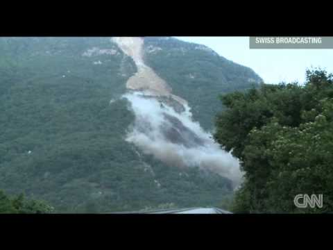 Swiss Alps mountainside disappear 300,000 cubic meters of rock to slide down a mountainside (видео)