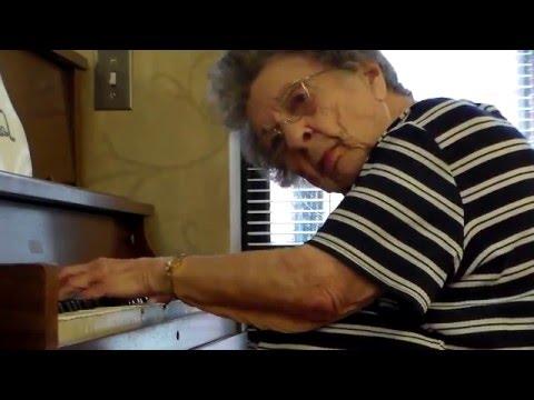 Elizabeth DeWald, 93, of Akron, Michigan, plays piano