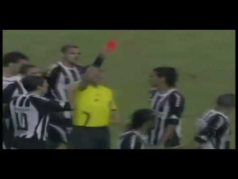 football player gives a yellow card the referee