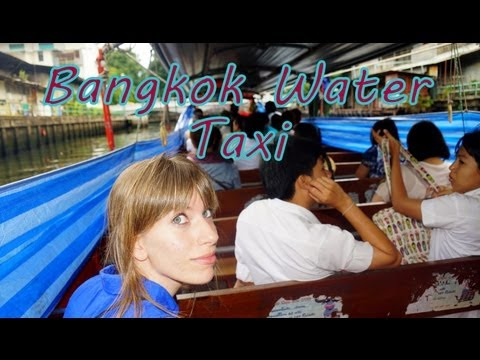 Water taxi boat ride nearby the Chao Phraya River in Bangkok, Thailand