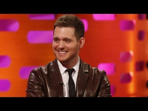 text message - http://www.bbc.co.uk/grahamnortonshow Graham gets Michael Buble to sing a text message on an audience members mobile phone.