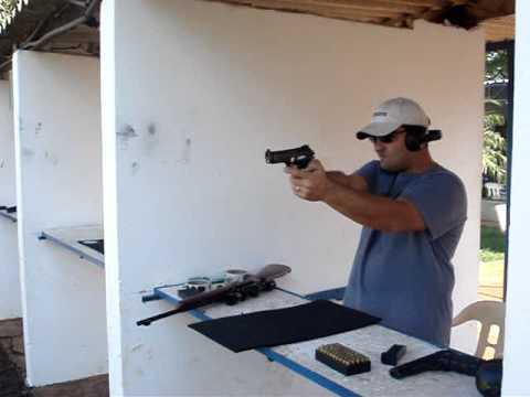 descarregando uma pistola tauros pt .380