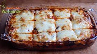 Etli,Kaşar Peynirli Musakka Tarifihttps://www.hayalimdekiyemekler.com/ana-yemekler/etlikasar-peynirli-musakka-tarifi/Etli,Kaşar Peynirli Musakka için Malzemeler4 adet orta boy  patlıcankızartmak için sıvıyağ çok az sıvıyağ ve tuziç  malzemesi için400 – 500 gr kırmızı  etyarim Çay bardağı siviyag1 adet buyuk boy kuru soğan1 adet kırmızı biberyarim cay kasığı kara biberyarim cay kaşığı pul biber1 tatlı kaşığı salçayarım çay bardağı sıcak suve  tuzSos için1 su bardağı sıcak suYarım çorba kaşığı  domates salçasıyarim cay kaşığı karabiberyarim cay kaşığı pul biberve tuzÜzeri için  Rendelenmiş Kaşar PeyniriPatates Püreli Etli Karnıyarık Nasıl YapılırPatlıcanları alacalı soyun 20 dakika tuzlu suda bekletin.Suyunu süzün,üzerine biraz sıvıyağ ve tuz gezdirip iyice karıştırın tos makinesinde kızartın.Eti kuşbaşından daha kucuk olacak şekilde kesin eğer dana  veya koyun etiyse uzerini gececek kadar su koyup  önceden yumuşayana kadar kaynatın et suyunu çekip yumuşayınca ocaktan alin  kuzu eti kullanacaksanız eti önceden haşlamanıza gerek yok,Büyük bir tavada biraz sıvıyağla soğanlar  sararana kadar soteleyin üzerine kırmızı biberi ekleyin,biberler hafif kızarınca eti tuzu,karabiberi,pul biberi  kekiği ve salçayı ilave  iyice karıştırın ve sıcak suyu ilave edip son bir kez daha karıştırıp ocaktan alın.Küçük veya orta boy borcama 1 sıra patlıcan 1 sıra etli karışımdan dökün .Aynı tavaya çok az sıvıyağ salça,tuz.karabiber ve pul biberi kavurarak sıcak suyu ilave edin ocaktan alın etli musakkanın üzerine gezdirinEn son kaşar rendesini üzerine yayın ve Önceden ısıtılmış 200 derece fırında kızarana kadar pişirip servis yapınAfiyet Olsun.Sayfalarımı takibe alabilirsiniz :)Resimli Detaylı Püf Noktalarıyla Yemek Tarifleri http://www.hayalimdekiyemekler.com/Facebook : https://www.facebook.com/pages/Hayalimdekiyemekler/284836254958186?hc_location=timelineInstagram : http://instagram.com/hayalimdekiyemekler/Pinterest: http://tr.pinterest.com/0s0gfu6kgyq6qbj/Yeni Tarifler için Telefonunuza 