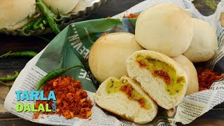Baked Vada Pav,Recipe Link : https://www.tarladalal.com/Baked-Vada-Pav--How-To-Make-Baked-Vada-Pav-40426rSubscribe : http://goo.gl/omhUioTarla Dalal App: http://www.tarladalal.com/free-recipe-app.aspxFacebook: http://www.facebook.com/pages/TarlaDalal/207464147348YouTube Channel: http://www.youtube.com/user/TarlaDalalsKitchen/featuredPinterest: http://www.pinterest.com/tarladalal/Google Plus:  https://plus.google.com/107883620848727803776Twitter: https://twitter.com/Tarla_DalalBaked Vada Pav / How to make Baked Vada PavFrom outside, it looks like a bread roll, but when you bite into it, it is a vada pav. That makes this lovely dish appeal to both camps – the sandwich lovers and the vada pav fans! Bread dough is layered with garlic chutney and stuffed with a peppy potato mixture before being baked to a perfectly golden colour, which makes it look and smell irresistible. A brushing of butter is the final master stroke, which makes it impossible to wait for your turn to grab a Baked Vada Pav! If you are not going to have this immediately after baking, allow it to cool completely and store it in an airtight container. Warm it in the Oven for five minutes just before serving.Preparation Time: 15 minutes.Cooking Time: 10 minutes.Makes 8 baked vada pavs.Baking Temperature:  200°C (400°F).Baking Time:  23 to 25 minutes. Resting Time:  45 minutes.For the dough2 cups plain flour (maida)1 tsp dry yeast1 tsp sugar1 tbsp soft butterSalt to tasteFor the potato stuffing1¼ cups boiled, peeled and mashed potatoes1 tbsp oil½ tsp mustard seeds (rai / sarson)4 curry leaves (kadi patta)¼ cup finely chopped onions1 tsp garlic (lehsun) paste2 tsp finely chopped green chillies¼ tsp turmeric powder (haldi)1 tbsp finely chopped coriander (dhania)1 tsp lemon juiceSalt to tasteOther ingredients8 tsp dry garlic chutneyMelted butter for brushingFor the dough1. Combine the dry yeast, sugar and 2 tbsp of lukewarm water in a small bowl, cover it with a lid and keep aside for 10 minutes.2. Combine th