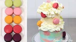 """Hi! Today I bring you a two tiers cake coated with basic buttercream icing and decorated with white modeling chocolate & macarons. The botom cake size is 4""""x 5"""" high (10cm x 12cm high). The top cake size is 6""""x 5"""" (15cm x 12cm high). ****More cake decorating videos****How To Make A Rose Swirl Cakehttps://youtu.be/rcLe-0sE6_sChocolate Mirror Glaze Cake Recipe CHOCOLATE HACKS by Cakes Step by Stephttps://youtu.be/5z5VWIBT3tMRoyal Icing Recipe for Brush Embroidery Cake - Decorando con GLASA REAL by CakesStepbyStephttps://youtu.be/Rv98z09man4High Heel Fashion CHOCOLATE Stiletto Shoe Cake - How To Make by CakesStepbyStephttps://youtu.be/M-0EkCYh2s0*To stay up to date with my latest videos, make sure to SUBSCRIBE to this YouTube channel (if you are not).*To find out more about the items I use, please visit: http://www.cakesstepbystep.com/*You can support this channel by sharing my videos. Thank you!*****************FOLLOW ME********************FACEBOOK     https://www.facebook.com/cakesstepbystep/*INSTAGRAM  http://instagram.com/cakesstepbystep/*PINTEREST    http://www.pinterest.com/cakesstepbystep/*TWITTER        https://twitter.com/CakesStepByStep/CakesStepbyStep is about cakes and cupcakes decorating with fondant and buttercream frosting. Also you can watch simple chocolate decoration techniques and cake recipes. Learn with me basic cake decoration techniques which will help you to decórate your own cake masterpiece. HAVE FUN! Music credit""""Beachball"""" by Silver Dolphin Musichttps://www.youtube.com/user/silverdolphinmusichttp://silverdolphinmusic.weebly.com/License Creative Commons CC BYhttp://creativecommons.org/licenses/by/4.0/#""""Dreams come true"""" by  Silver Dolphin Musichttps://www.youtube.com/user/silverdolphinmusichttp://silverdolphinmusic.weebly.com/License Creative Commons CC BYhttp://creativecommons.org/licenses/by/4.0/#"""