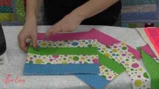 Stitch n flip, scrappy quilt as you go with double sided fusible cotton batting