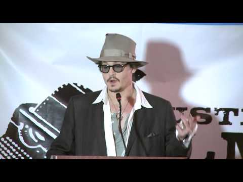 Johnny Depp (Film Actor) - Johnny Depp presents Caroline Thompson with the 2011 Distinguished Screenwriter Award at the 2011 Austin Film Festival Awards Luncheon.