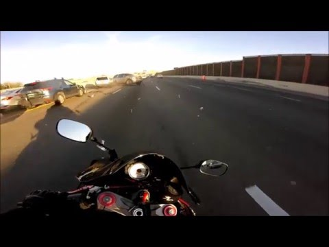 (VIDEO) Motorcyclist Dodges Car Crash At Last Second On Highway
