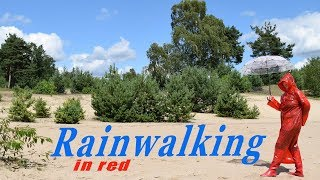 A Rainwalking in a electronic ambient soundscape with a red shiny macintosh and rubber Rainboots