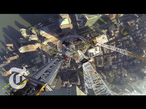 center - A time lapse of a video released by the Port Authority shows the spire being raised to the top of One World Trade Center. Please visit http://nyti.ms/10P0GuO...