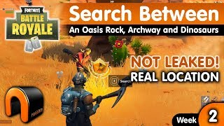 Search Between An Oasis Rock Archway and Dinosaurs FORTNITE