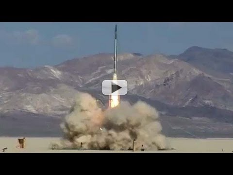 rocket - Team Qu8k's rocket blasts off on Sept. 30, 2011 from Nevada's Black Rock Desert, in pursuit of a $5000 prize for reaching 100000 feet and being recovered e...